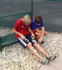 Middle School Athletes Playing with Rocks
